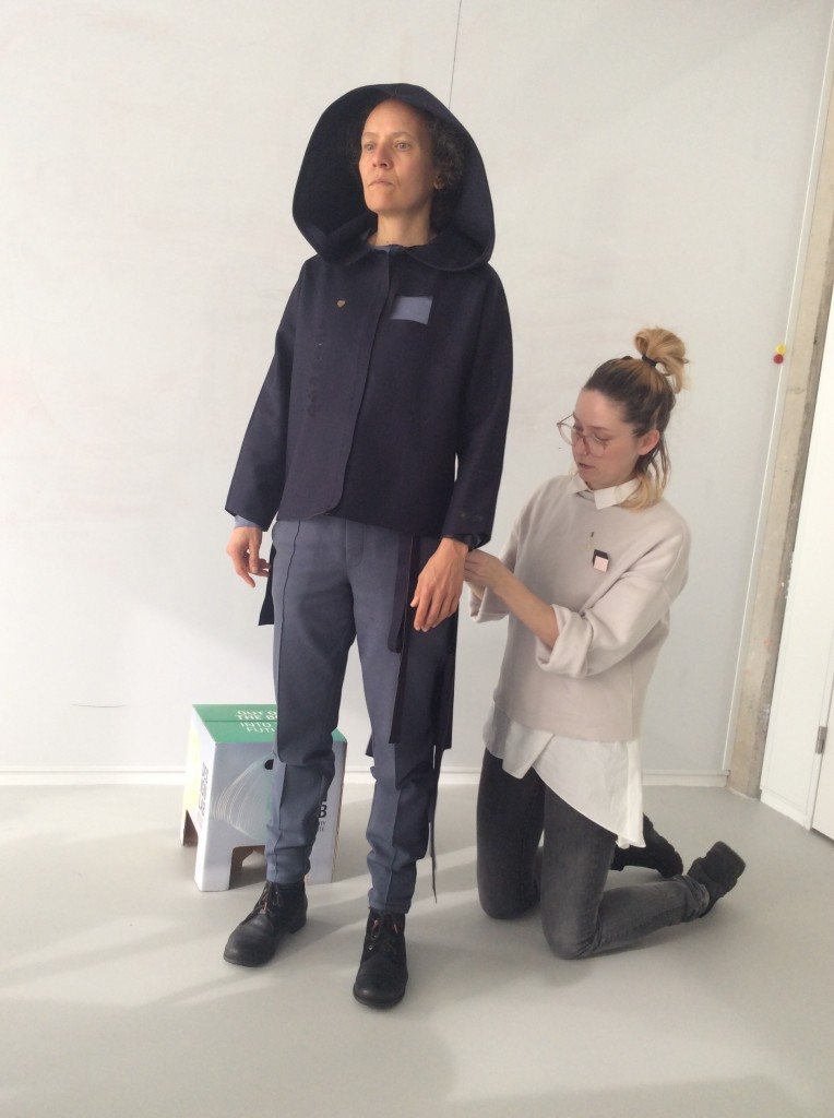 Danielle fitting the suit with Vera