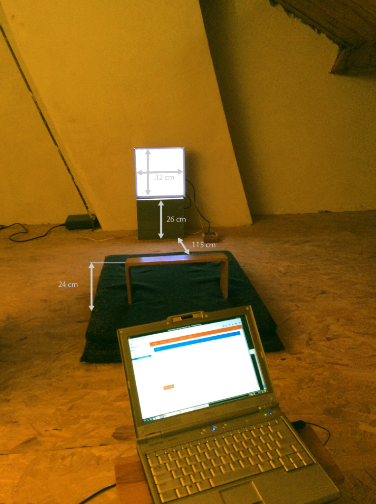 The lab set up: Light instrument, meditation mat and data server